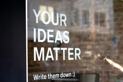 """window with text """"your ideas matters, write them down"""" on it"""