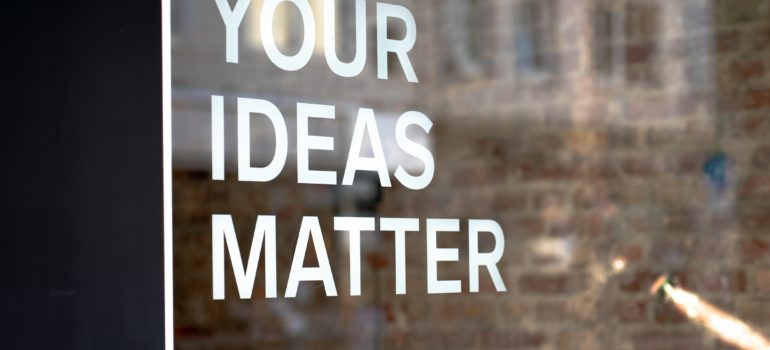 "window with text ""your ideas matters, write them down"" on it"
